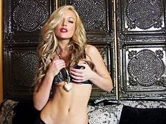 Kayden Kross reveals her natural beauty slowly by taking off her sexy lingerie. The big surprise comes when she spreads her legs and opens her pussy for a dildo.