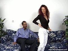Kinky redhead skank, wearing panties and bra, is having fun with a dude indoors. She gives a blowjob to the man and they fuck in the reverse cowgirl and the missionary positions.