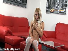 Amazing blonde in a sexy lingerie masturbates her pussy before bending over to show her hot ass then masturbates with a toy