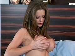 Gorgeous brown-haired chick Emily Addison, wearing thong and bra, demonstrates her terrific body for the camera. Then she spreads her legs wide open and entertains herself by fingering her coochie.