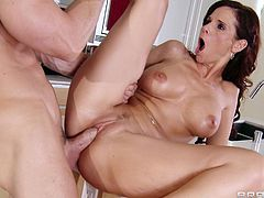 Sexy brunette mom Syren De Mer is having fun with Johnny Sins in the kitchen. She gives a deepthroat blowjob to the dude and they fuck ardently on the kitchen counter.