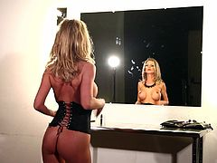 Have fun with this hot scene where the busty blonde Kimber Coxtakes off her bra and shows off her sexy body while wearing a corset.