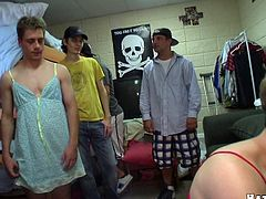 This group of frat house pledges is forced to dress up with some sexy girly lingerie and they end up sucking their big hard cocks.