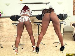 Two insatiable black sluts share a white boner in a hot FFM clip