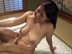 Horny Japanese woman in having fun with her husband indoors. She lets him play with her snatch and then sits down on his dick and they bang in the cowgirl position.