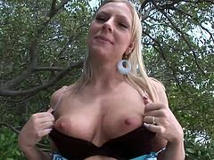 The amazing Britney Brooks is glad to show her huge natural tits and her big sexy ass and pussy from behind in the woods.