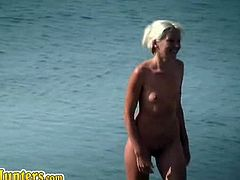 Nudist ladies spend their morning at the beach