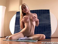 In the first scene, sweaty skinny blondie rubs her moist vag with pleasure. In the second scene, playful redhead skank pleases her muff with a toy. And blondie just spreads her legs and pisses on the floor.