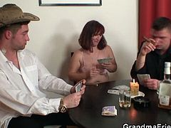 Horny granny was playing poker with two horny dudes and unfortunately she lost. She starts to blow two cocks at the same time and then took a nasty ride on one.