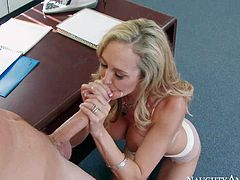 Boss Brandi Love is a good looking mature blonde with perfect huge tits. She strips down to her underwear in front of her new employee and takes his fat young dick in her eager mouth.