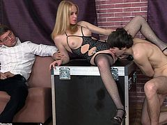 Lewd blonde Daikiri, wearing stockings, is having fun with two men in a basement. She spanks one of the dudes' butt, then shows her cock-sucking skills and enjoys rough sex.