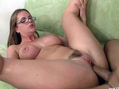 A girl in glasses gets her pussy banged in close up video