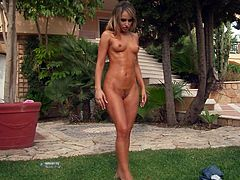 Stunning blonde girl takes off her clothes in a garden. Aleska Diamond pours water on her sexy body and then lies down on a ground. Aleska fingers her pussy until she cums.