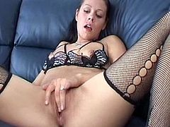Young Danish girl in black stockings loves posing while gently finger fucking her puffy twat in a sexy solo