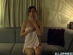 A sex hungry Japanese woman is alone in a house. Her hubby is at work. She can't wait for a long time. So, she fingers her dripping pussy until she cums.