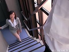 Kanari Tsubaki is a nasty Japanese teacher. She meets one of her students on the stairs and decides to have fun. She drops to her knees and gives a blowjob.