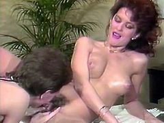 Dark and curly haired bitchy wench sits on sofa with legs spread apart and gets her ugly pussy eaten with pleasure by her ever hungry hubby. Just watch that hot oral sex in The Classic Porn sex video!