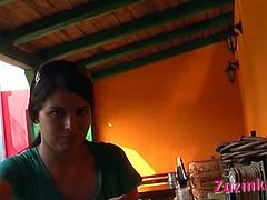 Zuzinka is a brunette exhibitionist. She plays with her pussy while sitting on a chair, in a public bar. She has no panties on, so she can easily finger herself.