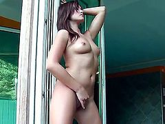 Dark haired beauty Tess Lyndon looks so hot and horny as she begins to play with her perfect naked body. watch as she gets in all sorts of positions as she plays with her lovely firm titties, and trimmed pussy.