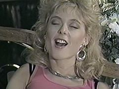Curly haired sexy blondie with nice shapes blows sweet penis of her thirsting guy in 69 style. Watch that hot cutie in The Classic Porn sex video!