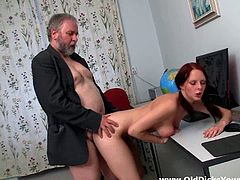 Share this with your friends! A redhead, with natural knockers wearing socks, goes really hardcore in an office after being forced at the beginning.