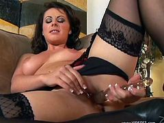 The gorgeous Penny Flame toys her hot wet pussy while she wears a sexy little black thong and gets a good taste of her juices.
