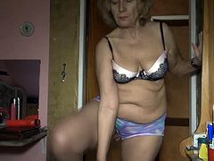 These old sluts are horny for some time together. The blonde lifts up her shirt and takes off her bra. Watch as she plays with her tits and then tease her pussy with an orange dildo. She bends over so her dark haired lover can stick the dildo inside her pussy.