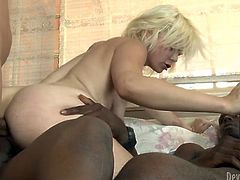 No other chick can fuck like this spoiled blonde does. Sex-starved skank feels comfortable having sex with three black men at once. Press play and get ready for the hottest gangbang sex video ever.