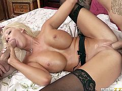 A hot, blonde cougar with big, fake tits and a great body enjoys a mind-blowing threesome fuck. Hear her moan with pleasure now!