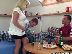 This grandmother breaks a party when she arrives home. She is left with two drunk guys who want to fuck her and she's a slut, so she takes both their cocks.