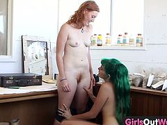 Make sure you don't miss these horny lesbo teenies showing off some amazing tricks to you. Watch as the green haired chick sticks her big fist in her friend's hole.