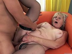 Light haired shameless granny in black stockings rested on sofa with legs spread apart and watched that hot guy licking her smelly pussy with passion. Have a look at that dirty sex in Fame Digital porn video!