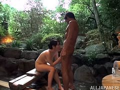 Riko Komori has a rest in Japanese outdoor bath. Then this cutie gives a blowjob and gets her hairy pussy fingered. After that she gets fucked from behind.