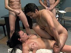 Sizzling brunette chick is playing dirty games with three studs in an office. She shows her cock-sucking talent to the men and gets banged in the missionary position and doggy style.