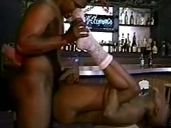 Bald black faggot stands on his knees and provides his partner with hot blowjob before licking his asshole. Then he gets his anus destructed doggystyle and mish on the table.