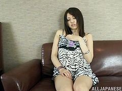 Sexy Asian girl Rino Mizusawa toys her clit with a big vibrator while she shoves a big ass dildo up her tight little pussy.