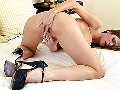 Emily Addison with juicy knockers and hairless bush gets satisfaction alone