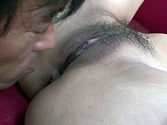 Lusty oriental gal spreads her stocking legs wide and dude dives in her muff. He spreads her pussy curtains and inserts his playful tongue deep in her juicy slit.