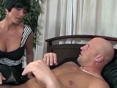 This milf had to hit on her step daughter's boyfriend because she was horny. When her daughter showed up, she agreed to share his cock with her step mommy. They both sucked on it.