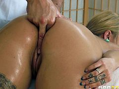 What are you waiting for? Watch this blonde pornstar, with a nice ass and natural breasts, while she goes hardcore with a horny dude covered in oil.