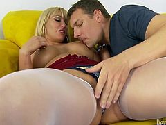 Blond haired hungry hoe with big boobs sat on sofa and spread her legs apart. That feverish guy set to eat her fat kitty with passion. Look at that hot cunnilingus in Fame Digital porn clip!
