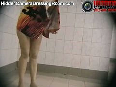 A spy cam in a showering room at a public pool records all kinds of women naked. They take off their swimming suits and wash their bodies. Some of them are hairy.