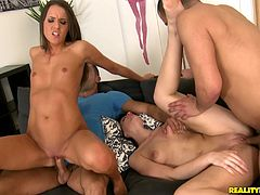 Long-haired hottie Adriana Brill and her sexy GF are having a great time with two men. They suck the dudes' schlongs and get banged in the reverse cowgirl and other positions.