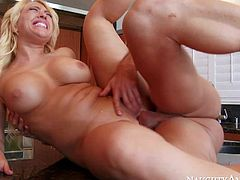 Horny wife Kagney Linn Karter invites Johnny Castle to come fuck her needy shaved pussy. Her husband is out of town and she is fuck hungry. He bangs big titted blonde wife with wild desire.