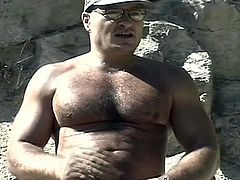 The sun is hot but these hard bodied muscled gay dads sizzle more in their outdoor cock stroking adventure to the max.