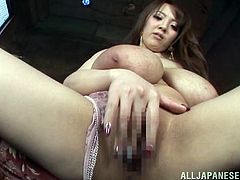 Curvy Japanese milf, wearing lingerie, is having a good time indoors. She kneads her massive natural boobs, then rubs her cunt and moans sweetly with pleasure.