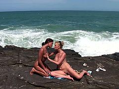 Two mind blowing babes take off their clothes outdoors demonstrating their big natural boobs. Afterwards they lick each other's drooling poontangs near the sea.