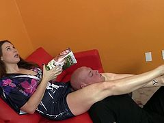 After using him as her foot stool for a while, Shauna Ryanne asks him to kneel in front of her. Then, she starts to slap his face with her feet and hands as well.