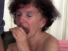 Mind blowing Russian granny blows hard black cock of young fellow