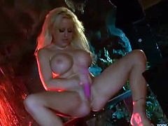 Slutty blonde milf Savannah Gold, wearing thong, is playing dirty games indoors. She kneads her big fake boobs and slams her snatch with a dildo afterwards.